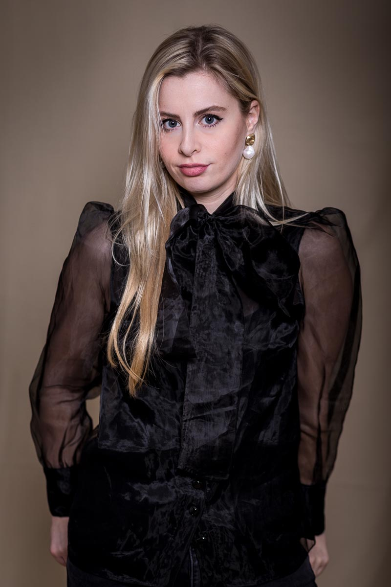 Portrait of a blond girl with black shirt