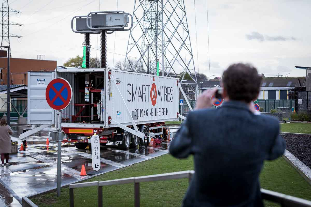 A visitor takes a picture of the Smart Wires truck before visiting it