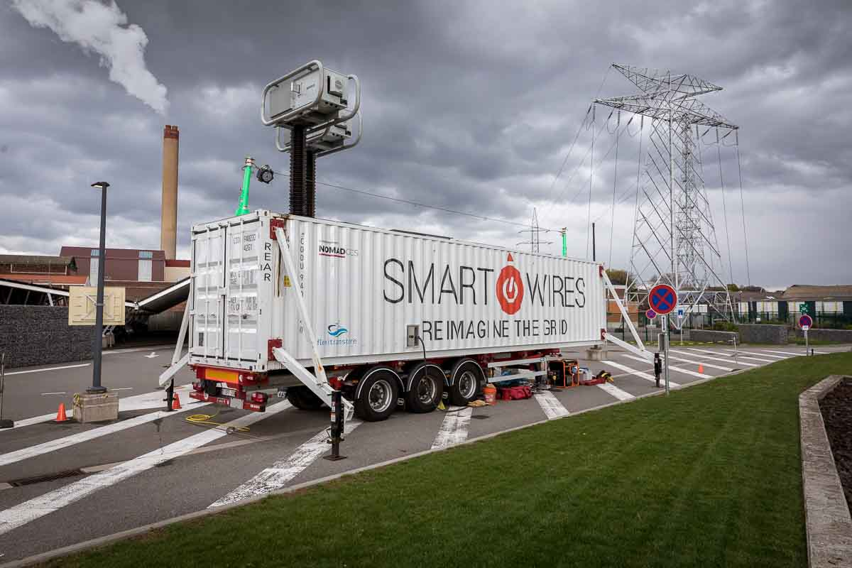 Smart Wires truck stands on a parking on a wide and cloudy scene