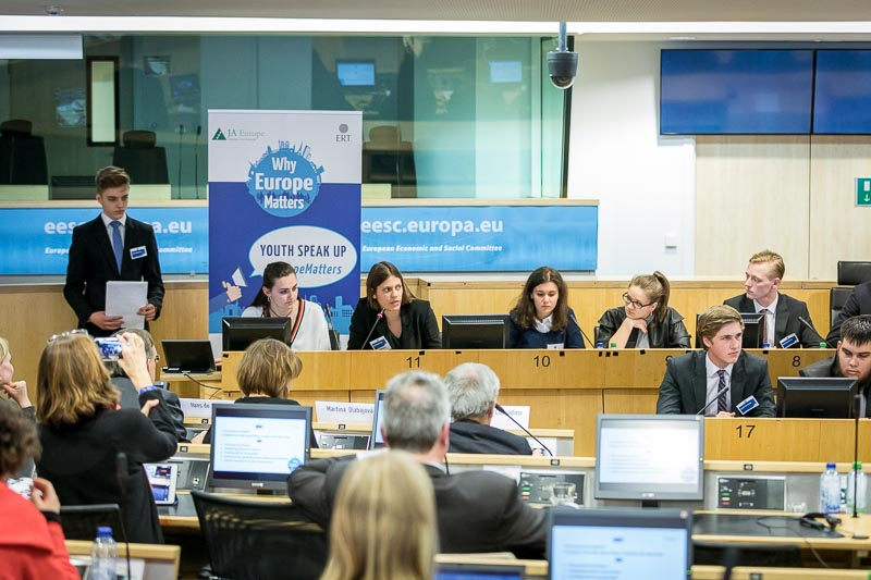 Group of students giving a presentation in the EU Parliament during the Why Europe Matters 2018 for JA Europe