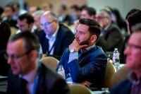 An attendee listens carefully in the audience during the CS International Conference 2018