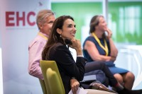 A woman in the panel smiles at the EHC Leadership Conference Day 1 in Brussels