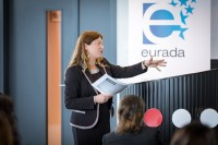 A woman speaker giving a presentation during the EURADA General Assembly 2018