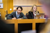 Attendees taking notes during the MCE Conference at the EU Parliament