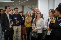 The audience applauds after a speech during the Stellenbosch University cocktail at the South African Embassy, Brussels
