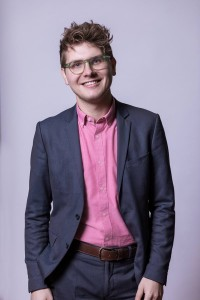 Corporate portrait of a man wearing a pink shirt and a blue jacket in Brussels