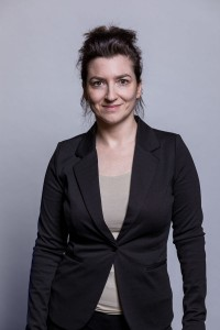 Corporate portrait of a woman wearing a black jacket
