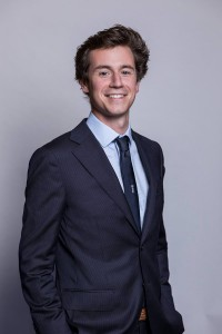 Corporate portrait of a young man wearing suit and tie in Brussels
