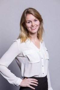 Corporate studio portrait of a blond woman wearing a white shirt