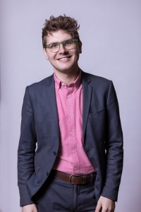 Corporate Portrait of a man wearing a pink shirt for ECOS in Brussels