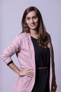 Corporate Portrait of a woman wearing a pink jacket for ECOS in Brussels