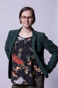 Corporate Portrait of a woman wearing a green jacket for ECOS in Brussels