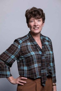 Corporate studio portrait of a woman wearing a lumberjack shirt