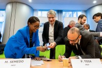 MEPs exchanging business cards during the Constitutive meeting of the Social Economy Intergroup