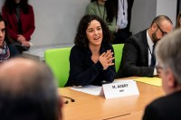 MEP Manon Aubry speaks and smiles during the Constitutive meeting of the Social Economy Intergroup