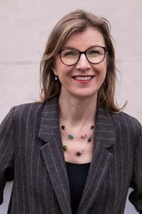 Portrait of Birgitta Bechtold wearing a gray jacket at Leopold Park, Brussels