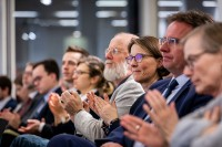 Members of the audience applauding after a speech finishes during the EU-China Connectivity event in Brussels