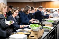 Attendees serving food from a buffet after the discussions during the EU-China Connectivity event in Brussels