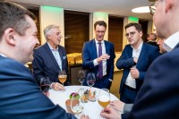 A group of attendees networking while having a drink during the EU-China Connectivity event in Brussels