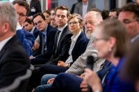 A closeup of audience while attendee poses a question during the EU-China Connectivity event in Brussels