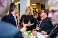 A blond woman networking with other attendees during the EU-China Connectivity event in Brussels