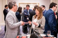 Two attendees exchange cards at the end of the conference during the GC Summit Belgium 2020