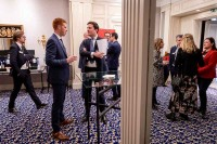Attendees networking during the coffee break at the GC Summit Belgium 2020