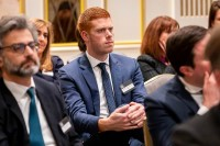 Closeup of a ginger man in the audience listening to a speech during the GC Summit Belgium 2020