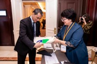 An attendee gets a goodie bag when registering during the 9th meeting of the WGECC in Brussels