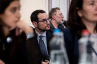 Closeup of an attendee carefully listening to a speech during the 9th meeting of the WGECC in Brussels