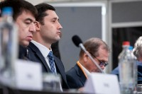 Closeup of an attendee listening to a presentation during the 9th meeting of the WGECC in Brussels