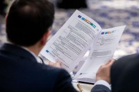 Closeup of the program hold by a participant during the 9th meeting of the WGECC in Brussels